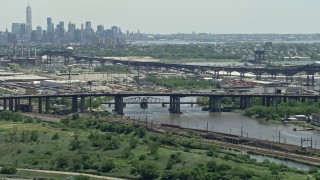AX83_098 - 5K stock footage aerial video of a small bridge over the Passaic River in Kearny, New Jersey