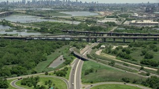 AX83_099 - 5K stock footage aerial video approaching New Jersey Turnpike with traffic, Kearny, New Jersey