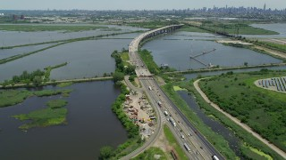 AX83_101 - 5K stock footage aerial video of New Jersey Turnpike bridge over the Hackensack River in Kearny, New Jersey