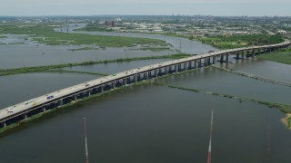 AX83_102 - 5K stock footage aerial video flying by NJ Turnpike bridge spanning Hackensack River in Kearny, New Jersey