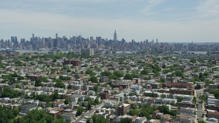 AX83_106 - 5K stock footage aerial video of Midtown Manhattan skyline seen from Jersey City urban neighborhoods, New Jersey & New York