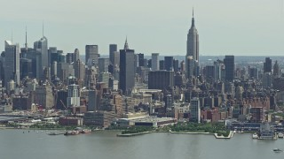 AX83_109 - 5K stock footage aerial video of Midtown Manhattan skyline and Hudson Yards seen from Hudson River, New York City