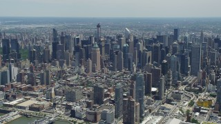 AX83_113 - 5K stock footage aerial video flying by Hell's Kitchen area of Midtown Manhattan, seen from Hudson River, New York City