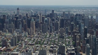 AX83_114 - 5K stock footage aerial video flying by Midtown Manhattan skyscrapers seen from Hell's Kitchen, New York City