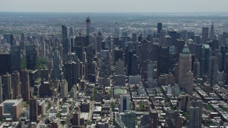 AX83_115 - 5K stock footage aerial video flying by Midtown and Upper East Side skyscrapers and Central Park, New York City