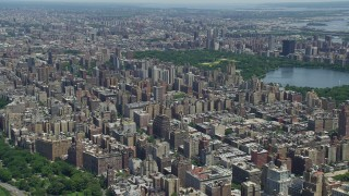 AX83_116 - 5K stock footage aerial video flying over Upper West Side high-rises in New York City