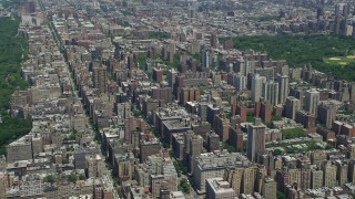 AX83_117 - 5K stock footage aerial video of Upper West Side high-rises and wide avenues, New York City