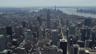 AX83_121 - 5K stock footage aerial video of Empire State Building and Lower Manhattan skyscrapers, New York City