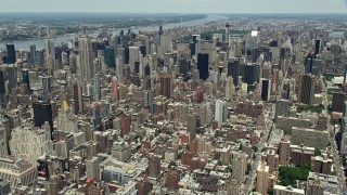 AX83_126 - 5K stock footage aerial video of a view of Midtown Manhattan skyscrapers, New York City