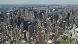AX83_128 - 5K stock footage aerial video Chrysler Buildings surrounded by Midtown Manhattan skyscrapers, New York City