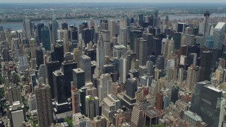 AX83_129 - 5K stock footage aerial video of the Chrysler Building and nearby skyscrapers in Midtown Manhattan, New York City