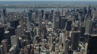 AX83_130 - 5K stock footage aerial video of Midtown Manhattan skyscrapers revealing Citigroup Center, New York City