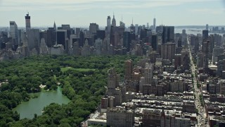 AX83_137 - 5K stock footage aerial video of Midtown Manhattan skyscrapers and Central Park, New York City