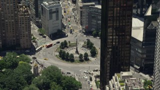 AX83_140 - 5K stock footage aerial video approaching and tilting to Columbus Circle in Midtown Manhattan, New York City