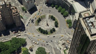 AX83_141 - 5K stock footage aerial video tilting to a bird's eye view of Columbus Circle in Midtown Manhattan, New York City