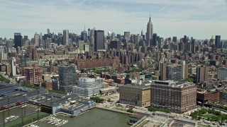 AX83_149 - 5K stock footage aerial video of Midtown Manhattan cityscape seen from Chelsea Piers, New York City