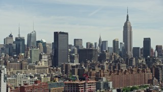 AX83_150 - 5K stock footage aerial video of One Penn Plaza, Empire State Building and Midtown Manhattan skyscrapers, New York City