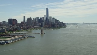 AX83_155 - 5K stock footage aerial video tilting from the Hudson River to reveal the World Trade Center, Lower Manhattan skyline, New York City