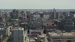 AX83_156 - 5K stock footage aerial video of city office buildings and apartments, Soho, New York City