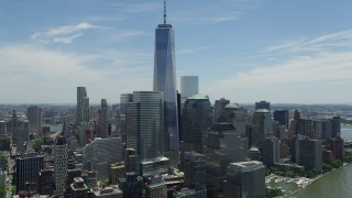 AX83_158 - 5K stock footage aerial video of One World Trade Center towering over Lower Manhattan skyscrapers, New York City