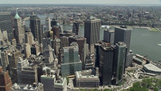 AX83_161 - 5K stock footage aerial video tilting to skyscrapers in Lower Manhattan, New York City