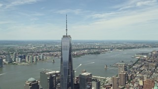 AX83_163 - 5K stock footage aerial video of One World Trade Center tilt down to reveal World Trade Center Memorial, Lower Manhattan, New York City