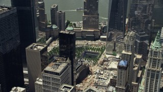 AX83_164 - 5K stock footage aerial video of World Trade Center Memorial, tilt to reveal One World Trade Center, Lower Manhattan, New York City