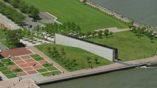 AX83_169 - 5K stock footage aerial video orbiting Empty Sky Memorial in Liberty State Park, Jersey City, New Jersey