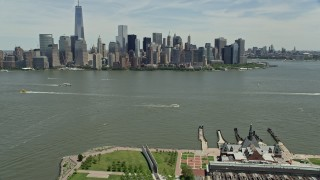 AX83_171 - 5K stock footage aerial video of Lower Manhattan skyline seen from Liberty State Park, New York City