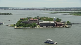 AX83_173 - 5K stock footage aerial video of Ellis Island in New York Harbor, New York City