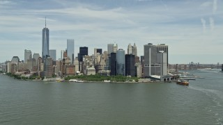 AX83_175 - 5K stock footage aerial video of Lower Manhattan skyline and Battery Park in New York City
