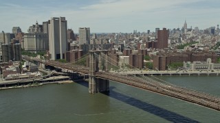 AX83_179 - 5K stock footage aerial video of Brooklyn Bridge in Lower Manhattan, New York City