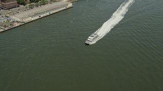 AX83_181 - 5K stock footage aerial video tracking a ferry cruising on the East River, New York City