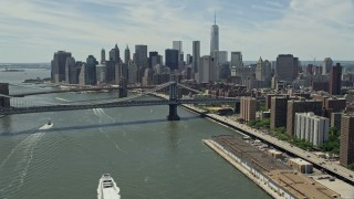 AX83_182 - 5K stock footage aerial video of Brooklyn and Manhattan Bridges, and the Lower Manhattan skyline, New York City