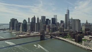 AX83_185 - 5K stock footage aerial video approaching the Brooklyn Bridge and Lower Manhattan skyline, New York City