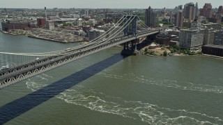 AX83_186 - 5K stock footage aerial video panning across Manhattan Bridge and approach Brooklyn, New York City