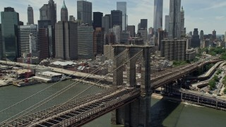 AX83_188 - 5K stock footage aerial video of Brooklyn Bridge near the Lower Manhattan skyline, New York City