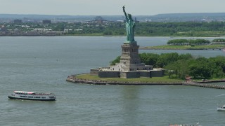 AX83_192 - 5K stock footage aerial video of tourists ringing the Statue of Liberty in New York Harbor, New York City