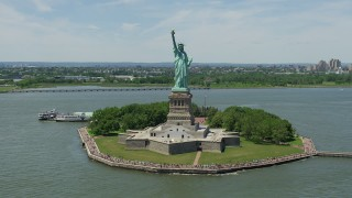 AX83_194 - 5K stock footage aerial video orbiting Statue of Liberty and reveal Lower Manhattan skyline, New York City