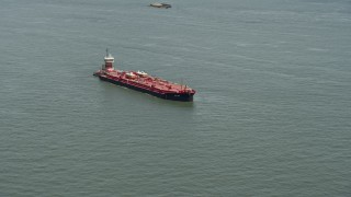 AX83_203 - 5K stock footage aerial video of an oil tanker sailing New York Harbor, New York