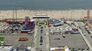 AX83_218 - 5K stock footage aerial video orbiting Luna Park and tilt to reveal Original Nathan's Famous Hot Dogs, Coney Island, Brooklyn, New York City