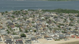 AX83_225 - 5K stock footage aerial video of a residential neighborhood near the water, Breezy Point, Queens, New York