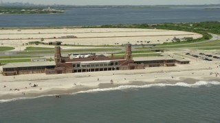 AX83_227 - 5K stock footage aerial video of beachgoers at Jacob Riis Park in Queens, New York