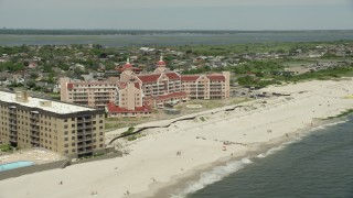 AX83_243 - 5K stock footage aerial video flying by a Beachside Condominium Complex, Lido Beach, New York