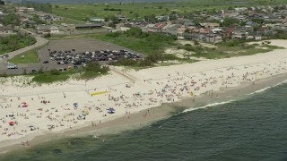 AX83_244 - 5K stock footage aerial video of sunbathers enjoying the beach and the Ocean, Lido Beach, New York
