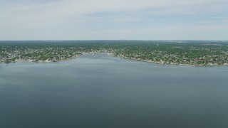 AX83_258 - 5K stock footage aerial video flying over South Oyster Bay to approach Massapequa, New York