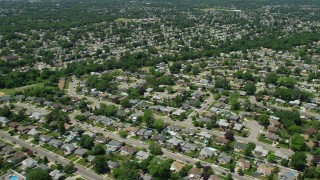 AX83_265 - 5K stock footage aerial video flying by Suburban Neighborhoods in Farmingdale, New York