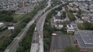 AX84_001 - 4K stock footage aerial video Flying over Jersey Turnpike, tilt up, Jersey City, New Jersey
