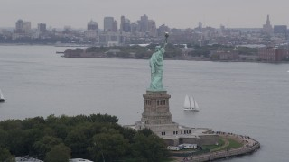 AX84_012 - 4K stock footage aerial video Flying by the Statue of Liberty, New York, New York