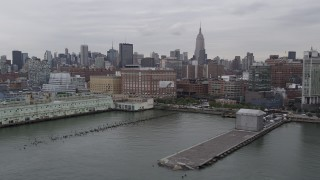 AX84_021 - 4K stock footage aerial video Flying by Chelsea Piers, Midtown Manhattan, Hudson River, New York, New York